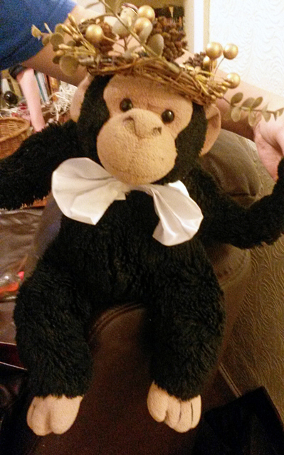 Ben the chimp at Christmas wearing a crown.