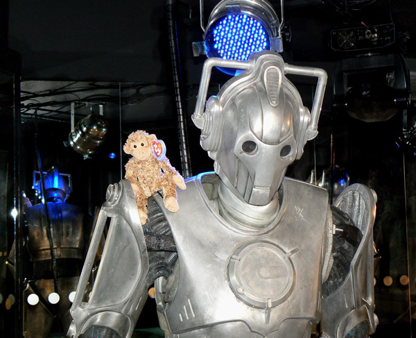 Bonsai sits on the shoulder of a Cyberman from Doctor Who.