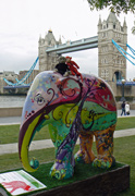 Mooch monkey meets a friend on an elephant at Tower Bridge during the Elephant Parade London 2010