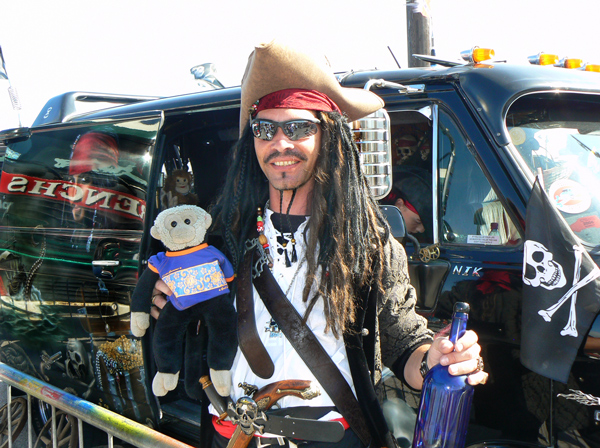Mooch monkey with a pirate at Hastings